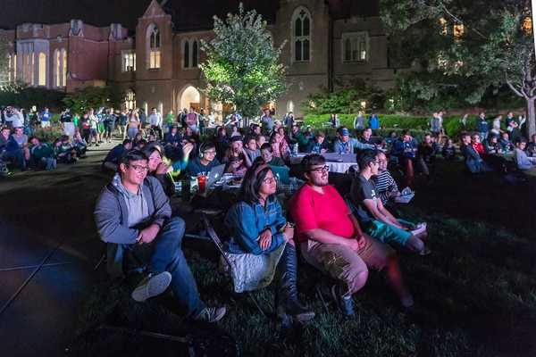 Students gather on the South Quad to watch a 2016 presidential debate.